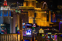 Colorful aerial view of the Las Vegas Strip illuminated at night, with the New York, New York and the Planet Hollywood casinos, Las Vegas Nevada