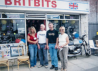 BNPS.co.uk (01202 558833)<br /> Pic: RayFisher/BNPS<br /> <br /> Pictured: Left to right Ray's daughter Stephanie, Ray, Ray's son Jerry and Ray's late wife Gweneth Fisher outside Britbits in 2009.<br /> <br /> Tireless Ray Fisher still works full-time in the motorcycle shop he opened 62 years ago - and he has plenty left in the tank.<br /> <br /> The 85 year old founded Ray Fisher's Brickbits in Christchurch, Dorset, in 1959 after training as a bike mechanic.<br /> <br /> It is a family affair as his two children Gerry, 58, and Stephanie, 54, have both worked solely for him since leaving school aged 16.<br /> <br /> Ray said he had loved bikes since childhood and learnt how to repair them while doing national service in the early 1950s.