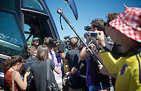 Nairo Quintana (COL/Movistar) giving interviews from the team bus at the start<br /> <br /> stage 17: Bern (SUI) - Finhaut-Emosson (SUI) 184.5km<br /> 103rd Tour de France 2016