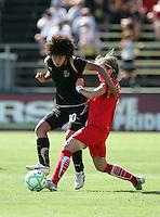 Eriko Arakawa (3) battles against Sonia Bompastor (right). FC Gold Pride defeated Washington Freedom 3-2 at Buck Shaw Stadium in Santa Clara, California on August 1, 2009.