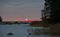 Chrystal Pool freighter glows orange at sundown in the southern Archipelagos of Finland