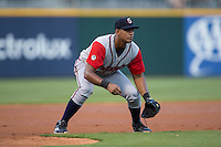 Gwinnett Braves third baseman Hector Olivera (15) on defense against the Charlotte Knights at BB&T BallPark on August 24, 2015 in Charlotte, North Carolina.  The Knights defeated the Braves 3-2.  (Brian Westerholt/Four Seam Images)