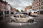 © Joel Goodman - 07973 332324 . 07/08/2011 . London , UK . A burned out police car on Tottenham High Street . Overnight rioting and looting in Tottenham , following a protest against the police shooting of Mark Duggan . Photo credit : Joel Goodman