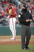 Arkansas starter Zebulon Vermillion reacts to the ruling from the replay booth Friday, April 2, 2021, as a game official looks on during the third inning of play against Auburn at Baum-Walker Stadium in Fayetteville. A double play was overturned, resulting in a run by Auburn. Visit nwaonline.com/210403Daily/ for today's photo gallery. <br /> (NWA Democrat-Gazette/Andy Shupe)
