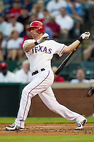 Texas Rangers designated hitter Michael Young #10 swings during the Major League Baseball game against the Baltimore Orioles on August 21st, 2012 at the Rangers Ballpark in Arlington, Texas. The Orioles defeated the Rangers 5-3. (Andrew Woolley/Four Seam Images).
