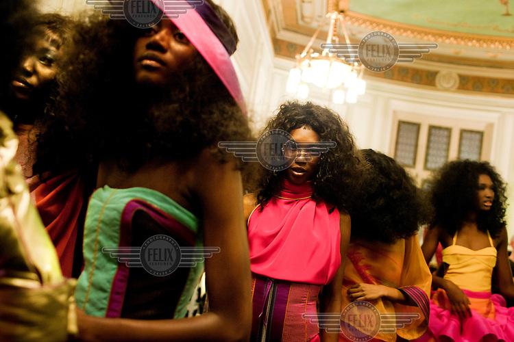 Models prepare backstage at the Julien Fournie fashion show during Paris Fashion Week.