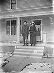 WINTER PORCH POSING. This young couple appears ready to step out on a wintry day. Presumably they found their way back home, despite the fact their address had lost one digit. That address could match numerous houses in Lincoln and the location has not been identified. The full-height Tuscan porch column and the cut shingles decorating the upper wall indicate a house that was built at the dawn of the 20th century.<br /> <br /> The woman is thought to be Lucile Miller.<br /> <br /> Photographs taken on black and white glass negatives by African American photographer(s) John Johnson and Earl McWilliams from 1910 to 1925 in Lincoln, Nebraska. Douglas Keister has 280 5x7 glass negatives taken by these photographers. Larger scans available on request.