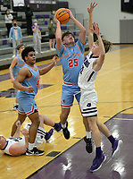 Fort Smith Southside's Ethan Vaughn (25) takes a shot Tuesday, Jan. 12, 2021, as he is pressured by Fayetteville's  Paiden Pope (right) during the first half of play in Bulldog Arena. Visit nwaonline.com/210113Daily/ for today's photo gallery. <br /> (NWA Democrat-Gazette/Andy Shupe)