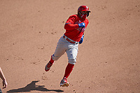 Philadelphia Phillies Ronald Torreyes (74) running the bases during a Major League Spring Training game against the Baltimore Orioles on March 12, 2021 at the Ed Smith Stadium in Sarasota, Florida.  (Mike Janes/Four Seam Images)