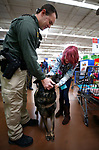 Carson City Sheriff's Deputy Brett Bindley and his K-9 Ivo talk with Sheyann, 12 during the 15th annual Holiday with a Hero program at Walmart in Carson City, on Wednesday, Dec. 19, 2018. The program pairs 240 K-8 students from the Carson City School District's McKinney-Vento program with first responders for a $100 Christmas shopping spree.<br /> Photo by Cathleen Allison/Nevada Momentum