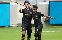 LOS ANGELES, CA - OCTOBER 25: Carlos Vela #10 of LAFC celebrates his goal with teammate Latif Blessing #7 during a game between Los Angeles Galaxy and Los Angeles FC at Banc of California Stadium on October 25, 2020 in Los Angeles, California.