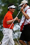 PALM BEACH GARDENS, FL. - Y.E. Yang pounds fists with his caddie after a birdie on hole 4 to go 9 under par during final round play at the 2009 Honda Classic - PGA National Resort and Spa in Palm Beach Gardens, FL. on March 8, 2009.