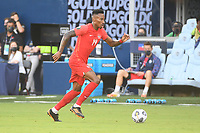 KANSAS CITY, KS - JULY 15: Mark-anthony Kaye #14 of Canada with the ball during a game between Canada and Haiti at Children's Mercy Park on July 15, 2021 in Kansas City, Kansas.