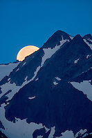 Moon set over the Olympic Mountains. Olympic National Park, Washington