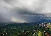 aerial photograph of a rainbow appearing during a storm in Chiapas, Mexico