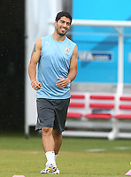 Luis Suarez of Uruguay laughs as he jokes around during training ahead of tomorrow's Group D fixture vs Italy