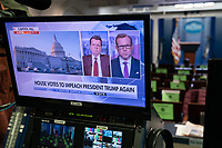 Seen on a monitor in the White House Press Briefing Room in Washington, DC, the U.S. House of Representatives voted to impeach U.S. President Donald Trump, January 13, 2021. Credit: Chris Kleponis / Pool via CNP /MediaPunch