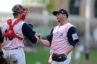 Relief pitcher Jonathan Aro (37) of the Greenville Drive, right, shakes hands with catcher Jordan Weems after winning a game against the West Virginia Power on Sunday, May 11, 2014, at Fluor Field at the West End in Greenville, South Carolina. Greenville won, 9-6. (Tom Priddy/Four Seam Images)