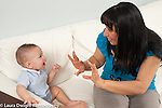 7 month old baby boy interested in mother's hand gestures