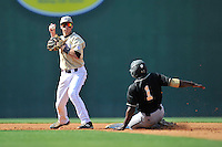 Left fielder Demetrius Jennings (1) of the Wofford Terriers is out at second in a SoCon Tournament game against Western Carolina on Wednesday, May 25, 2016, at Fluor Field at the West End in Greenville, South Carolina. Western won, 10-9. (Tom Priddy/Four Seam Images)