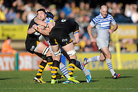 Brad Barritt of Saracens is tackled during the Aviva Premiership match between London Wasps and Saracens at Adams Park on Saturday 29th March 2014 (Photo by Rob Munro)