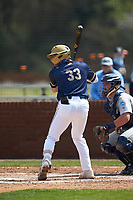 Carter Foster (33) of the Queens Royals at bat against the Catawba Indians during game one of a double-header at Tuckaseegee Dream Fields on March 26, 2021 in Kannapolis, North Carolina. (Brian Westerholt/Four Seam Images)