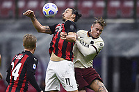 Zlatan Ibrahimovic of AC Milan and Rick Karsdorp of AS Roma compete for the ball during the Serie A football match between AC Milan and AS Roma at San Siro Stadium in Milano  (Italy), October 26th, 2020. Photo Image Sport / Insidefoto