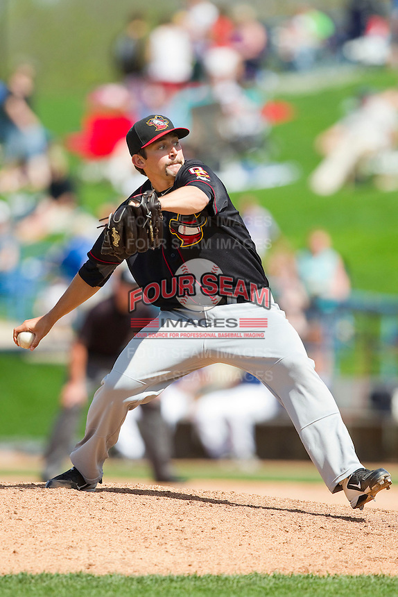 Quad Cities River Bandits relief pitcher Daniel Minor (13) in action against the West Michigan Whitecaps at Fifth Third Ballpark on May 5, 2013 in Comstock Park, Michigan.  The River Bandits defeated the Whitecaps 5-4.  (Brian Westerholt/Four Seam Images)