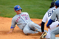 New York Mets catcher Anthony Recker #20 slides into third being tagged out by Matt Tuiasosopo #68 during a Spring Training game against the Detroit Tigers at Joker Marchant Stadium on March 11, 2013 in Lakeland, Florida.  New York defeated Detroit 11-0.  (Mike Janes/Four Seam Images)