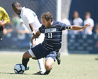 Jose Colchao #11 of Georgetown University  keeps the ball from Nosa Iyoha #21 of Michigan State during an NCAA match at North Kehoe Field, Georgetown University on September 5 2010 in Washington D.C. Georgetown won 4-0.