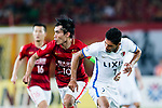 Kashima Forward Pedro Junior (R) in action against Guangzhou Midfielder Zheng Zhi (L) during the AFC Champions League 2017 Round of 16 match between Guangzhou Evergrande FC (CHN) vs Kashima Antlers (JPN) at the Tianhe Stadium on 23 May 2017 in Guangzhou, China. (Photo by Power Sport Images/Getty Images)