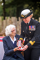 BNPS.co.uk (01202 558833)<br /> Pic: MaxWillcock/BNPS<br /> <br /> Pictured: Commodore Jude Terry presents Lorna Cockayne with the prestigious Legion d'Honneur.<br /> <br /> A brilliant Bletchley Park codebreaker who enabled the Allies to read crucial messages before Adolf Hitler received them has today been awarded the prestigious Legion d'Honneur.<br /> <br /> Lorna Cockayne, now aged 96, worked on the 'Colossus' computer which cracked the Lorenz code used by German generals to brief the Nazi leader.<br /> <br /> She fed in tape and counted letters to decipher intercepted messages for eight hours daily without a break as the giant machine never stopped.<br /> <br /> The intelligence she uncovered was particularly important in the lead-up to the D-Day landings in June 1944.