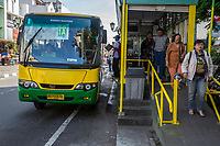 Yogyakarta, Java, Indonesia.  Passengers Exiting from a Bus Stop,  Jalan Malioboro Street.