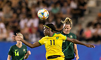 GRENOBLE, FRANCE - JUNE 18: Khadija Shaw #11 of the Jamaican National Team, Emily Van Egmond #10 of the Australian National Team battle for head ball during a game between Jamaica and Australia at Stade des Alpes on June 18, 2019 in Grenoble, France.