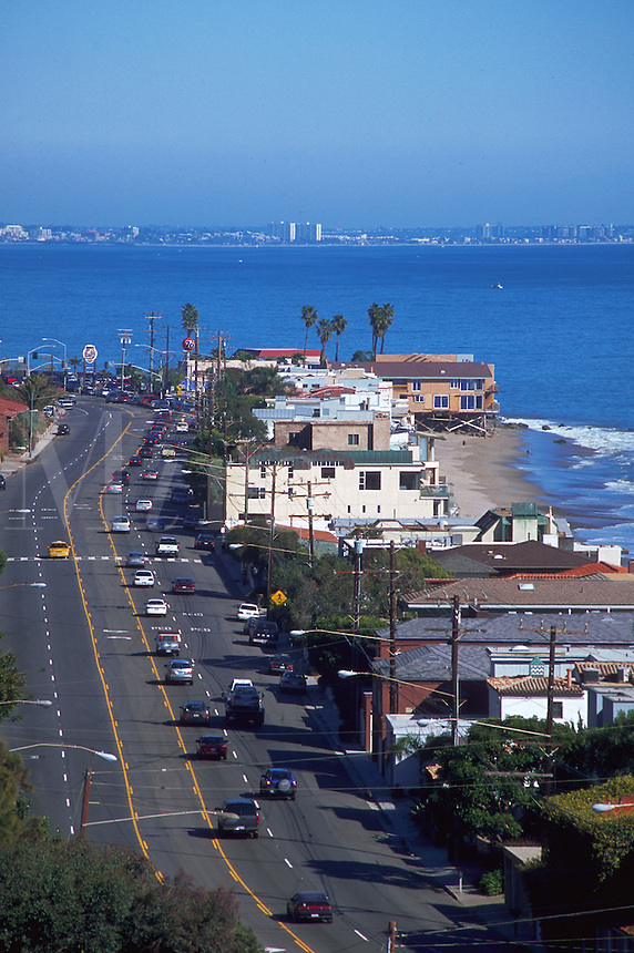 Overview of homes and the Pacific Ocean coastline along California State Highway One.