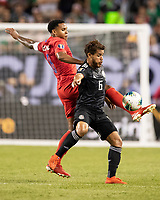 CHICAGO, IL - JULY 7: Weston Mckennie #8 and Jonathan Dos Santos #6 go for the ball during a game between Mexico and USMNT at Soldiers Field on July 7, 2019 in Chicago, Illinois.
