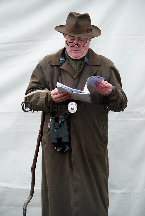 Robert Dore, National Hunt Steward, reading his race card at the County Clare Hunt Point To Point in Bellharbour. Photograph by John Kelly.