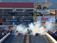 Feb 24, 2018; Chandler, AZ, USA; NHRA pro stock driver Erica Enders-Stevens (left) does a burnout alongside Tanner Gray during qualifying for the Arizona Nationals at Wild Horse Pass Motorsports Park. Mandatory Credit: Mark J. Rebilas-USA TODAY Sports