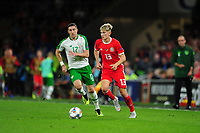 Stephen Ward of Republic of Ireland vies for possession with David Brooks of Wales during the UEFA Nations League B match between Wales and Ireland at Cardiff City Stadium in Cardiff, Wales, UK.September 6, 2018