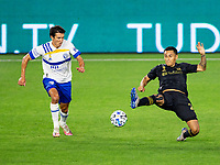 LOS ANGELES, CA - SEPTEMBER 02: Shea Salinas #6 of the San Jose Earthquakes and Andy Najar #24 of LAFC battle for a ball during a game between San Jose Earthquakes and Los Angeles FC at Banc of California stadium on September 02, 2020 in Los Angeles, California.