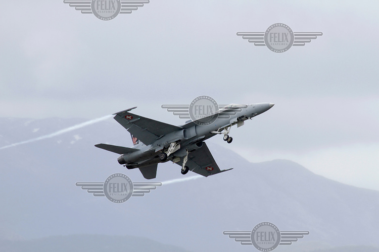 Swiss F-18 Hornet taking off during Tiger Air show.  Nato Tiger Meet is an annual gathering of squadrons using the tiger as their mascot. While originally mostly a social event it is now a full military exercise. Tiger Meet 2012 was held at the Norwegian air base Ørlandet.