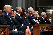 From left, President Donald Trump, first lady Melania Trump, former President Barack Obama, Michelle Obama, former President Bill Clinton, former Secretary of State Hillary Clinton, and former President Jimmy Carter listen as former President George W. Bush speaks during a State Funeral at the National Cathedral, Wednesday, Dec. 5, 2018, in Washington, for former President George H.W. Bush.<br /> Credit: Alex Brandon / Pool via CNP