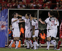 The USA celebrates after a Landon Donovan goal against Panama in the first half in Panama City, Panama, Wednesday, June 8, 2005. USA won 3-0.