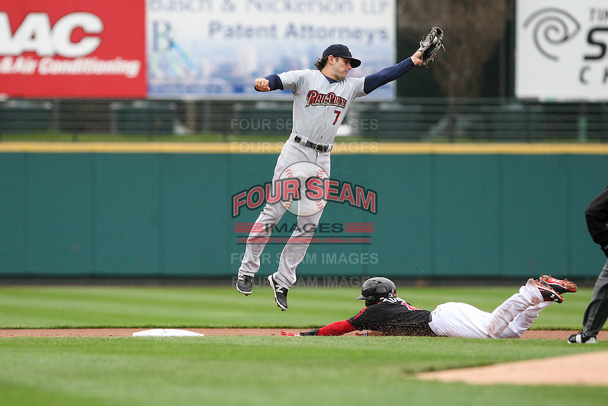 Scranton Wilkes-Barre Railriders shortstop Pete Kozma (7) leaps to catch a throw from home plate as Wilfredo Tovar (4) of the Rochester Red Wings steals second on May 1, 2016 at Frontier Field in Rochester, New York. Red Wings won 1-0.  (Christopher Cecere/Four Seam Images)