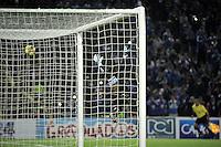 BOGOTA- COLOMBIA -19 -02-2014: Luis Delgado jugador de Millonarios (Fuera de Cuadro), anota gol a Jose Cuadrado, portero del Once Cladas durante partido de la sexta fecha de la Liga Postobon I 2014, jugado en el Nemesio Camacho El Campin de la ciudad de Bogota. / Luis Delgado player of Millonarios (Out of Pic) scored a goalto Jose Cuadrado, goalkeeper of Once Caldas during a match for the sixth date of the Liga Postobon I 2014 at the Nemesio Camacho El Campin Stadium in Bogota city. Photo: VizzorImage  / Luis Ramirez / Staff