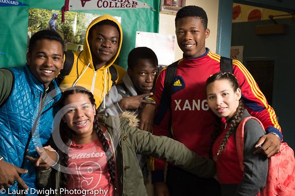 Education high school classroom scenes group of happy students posing in corridor