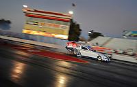 Jan 25, 2009; Chandler, AZ, USA; NHRA funny car driver Mike Neff does a burnout during testing at the National Time Trials at Firebird International Raceway. Mandatory Credit: Mark J. Rebilas-
