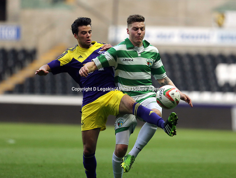 Thursday, 16 April 2014<br /> Pictured L-R: Sam Evans of Swansea challenged by a TNS player <br /> Re: FAW Youth Cup Final, Swansea City FC v The New Saints FC at the Liberty Stadium, south Wales,