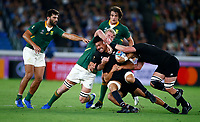 Ardie Savea is tackled during the Rugby World Cup Pool B match between the New Zealand All Blacks and South Africa Springboks at the International Stadium in Yokohama, Japan on Saturday, 21 September, 2019. Photo: Steve Haag / stevehaagsports.com
