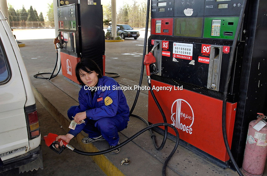A Sinopec gas station in Beijing, China. While poor in petroleum, China is rich in coal, which the country uses to generate over 75% of its electricity..